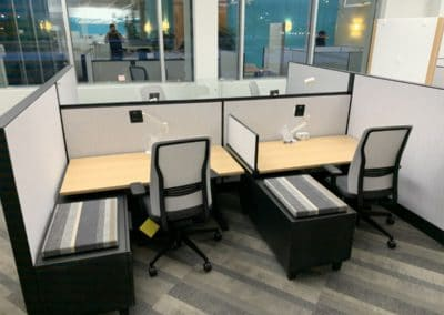 Open concept office furniture installation example - double cubicles with small wall in between