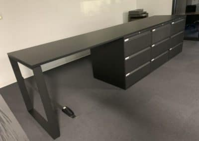 Office desk with 9 storage units - ideal for common area
