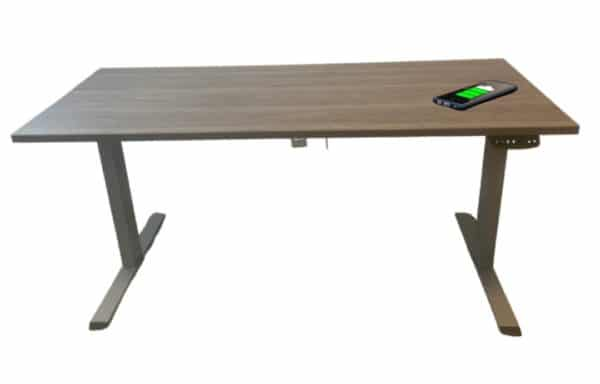 Office desk with wireless charging station built-in